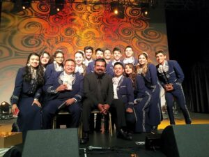 Actor George Lopez with members of Mariachi Huenachi