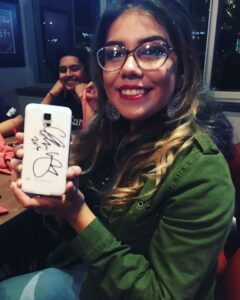 Vianca Guzman had her cell phone signed by Lopez