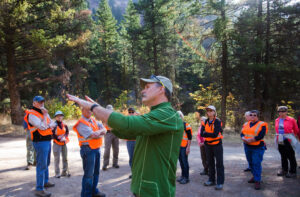 Ecologist Paul Hessburg, center, talks with a group about the forest ecology up Hay Canyon, where there have been two forest fires since 2004. Mike Bonnicksen photo.