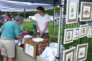 Artist Charlotte Massey peddles her art at the market