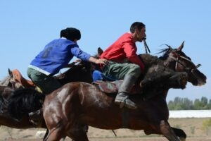 The sport of Kok-boru involves riders battling for control of a goat carcass