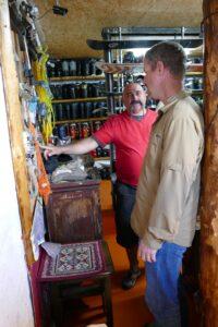 Igor Khanin shows Mission Ridge GM Josh Jorgensen his skiing equipment