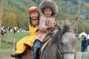 Young nomads on horseback