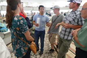 Our team visiting a market in Samarkand, Uzbekistan. From left, Sarah Lindell, our guide, Wil Jorgensen, Josh Jorgensen and Tom Warren