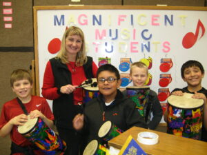Teacher Gail Morris of Tonasket with drums funded through the North Central Education Foundation