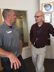 Wenatchee School District technology leader Ron Brown, left, with Ed Phinney, CEO of Pacific Aerospace and Electronics