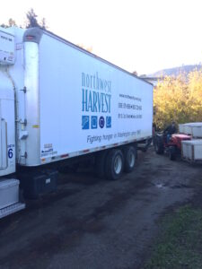 A Northwest Harvest truck hauled the fresh apples to a regional distribution center.