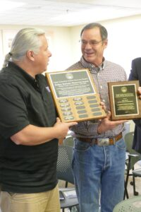 Yakama Nation Fisheries manager Paul Ward gives Ron Walter the Esther Stefaniw Award.
